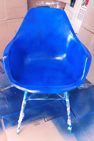 chair in progress with blue spray paint